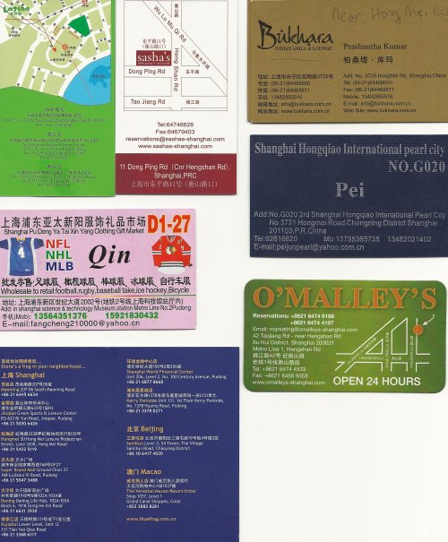 Scan of some useful SH business cards.  Clockwise from upper left:  Latina (green) Brasilian restaurant in the shopping under Science & Tech museum, Sasha's bar/restaurant, Bukhara Indian restaurant near Hong Mei pearl mkt, Card for pearl vendor in Hong Mei Lu (use it to get there), O'Malley's, Blue Frog locations, and card for jersey shop (pink) at Science & Tech museum shopping